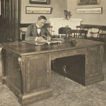President MacLaurin sitting at the desk presented by the Technology Club of New York, 1917