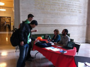 Katharine Dunn and Mark Clemente field questions at an information table during Open Access week