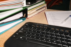 keyboard and notebooks on a desk