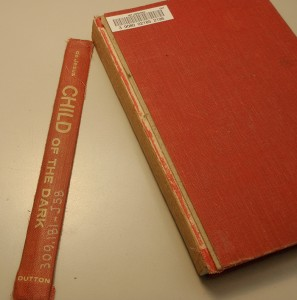 Book with original spine cloth detached