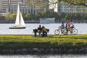 Cyclists riding along the Charles River across from MIT's Campus