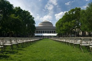 MIT building 10 lawn with graduation chairs and stage